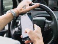 Водій за кермом маршрутки з пасажирами грав ігри на смартфоні (відео)